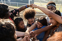 From left: Freshmen Quataysia Dixon, 14 (CQ) Armani Perkins, 14 (CQ), Jayla Wilkins ,14, (CQ) Gisell Cervantes,14, (CQ) junior Tyreke Speight, 16, (CQ) and Dylan Mendez, 14, (CQ) form a human knot and try to untangle themselves. The students are part of the Peer Group Connection mentor program at Greene Central Central High School, and met each other during a field day. Snow Hill, NC Friday, September 22, 2017. (Justin Cook for Education Week)