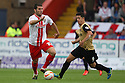 Dani Lopez of Stevenage races away from Lloyd James of Leyton Orient<br />  - Stevenage v Leyton Orient - Sky Bet League 1 - Lamex Stadium, Stevenage - 17th August, 2013<br />  © Kevin Coleman 2013