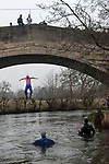 Mappleton Derbyshire 2020. New Years Day Okeover Bridge Jump. Jumping into the River Dove. A New Years 30 years old tradition which celebrates the life of Jim Breeze, a founder of the jump. A collection is made for local charities.