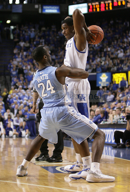 North Carolina guard Justin Watts wraps his arms around UK forward Terrence Jones during the first half of UK's home game against North Carolina at Rupp Arena in Lexington, Ky., Dec. 1, 2011. Photo by Brandon Goodwin
