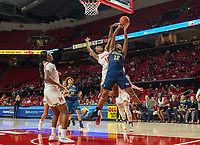 COLLEGE PARK, MD - NOVEMBER 20: Diamond Miller #14 of Maryland and Olivia Gumbs #12 of George Washington clash under the basket during a game between George Washington University and University of Maryland at Xfinity Center on November 20, 2019 in College Park, Maryland.