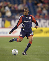 New England Revolution defender Darrius Barnes (25) passes the ball. The Columbus Crew defeated the New England Revolution, 1-0, at Gillette Stadium on October 10, 2009.