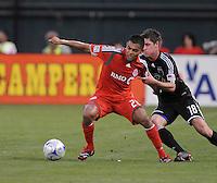 Toronto FC. midfielder Amado Guevarra (20) shields the ball against DC United defender Devon McTavish (18).   DC United tied Toronto FC. 3-3 at  RFK Stadium, Saturday May 9, 2009.