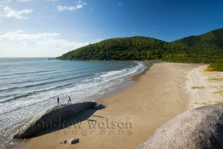 Hikers on the beach at Cherry Tree Bay.  Cooktown, Queensland, Australia