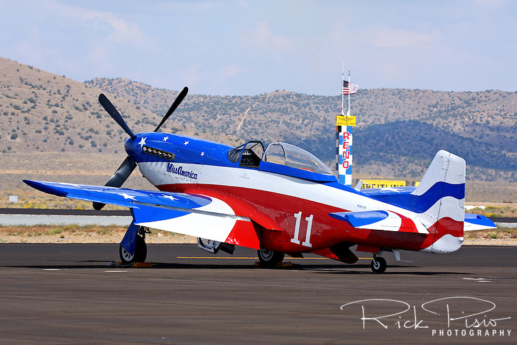 "Brent Hisey's P-51D Mustang ""Miss America"" sits on the tarmac during the 2011 Reno National championship Air Races at Stead Field in Nevada."