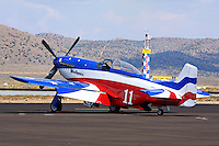 """Brent Hisey's P-51D Mustang """"Miss America"""" sits on the tarmac during the 2011 Reno National championship Air Races at Stead Field in Nevada."""