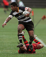 Ories halfback Rob Faataofe beats his Poneke opposite brad Faulkner..Wellington Club Rugby - Swindale Shield, Poneke v Oriental-Rongotai at Kilbirnie Park, Wellington, Saturday, 23 May 2009. Photo: Dave Lintott/lintottphoto.co.nz