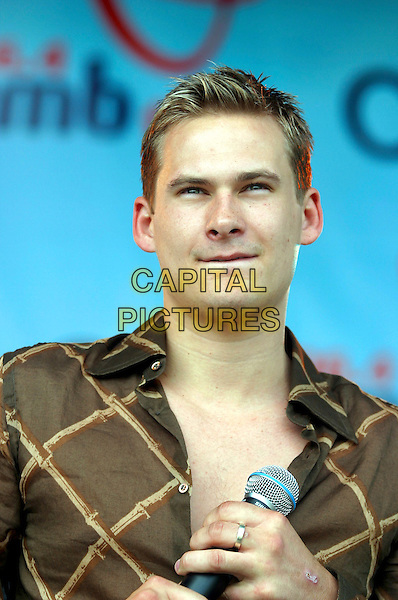 LEE RYAN.Performs live in concert at 96.4 BRMB's Party In The Park, Cannon Hill Park, Birmingham, .July 3rd 2005..portrait headshot chest gig brown shirt.Ref: JEZ.www.capitalpictures.com.sales@capitalpictures.com.©Jez Self/Capital Pictures