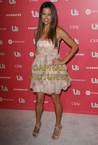 BROOKE BURKE.The US Weekly Hot Hollywood Party at Eden in Hollywood, California, USA..April 26th, 2011 .full length dress cream pink beige strapless print hand on hip shoes open toe platform .CAP/ADM.©AdMedia/Capital Pictures.