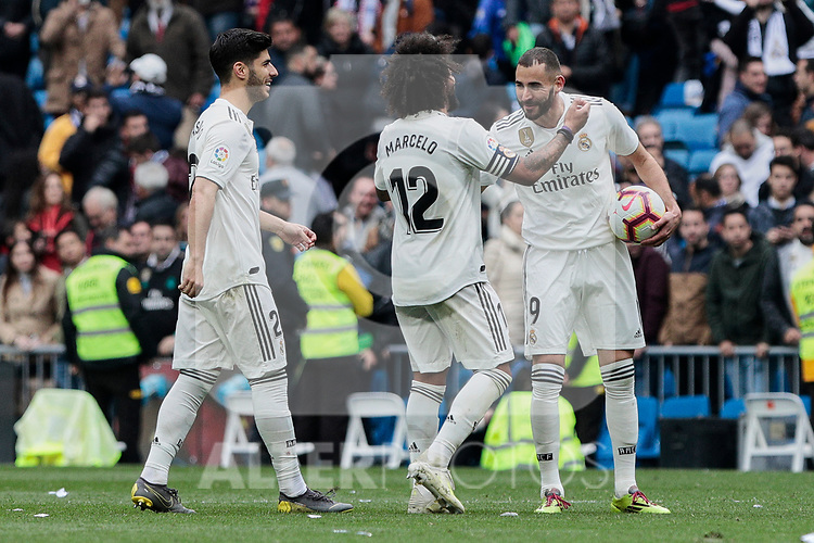 Real Madrid's Marcelo Vieira (L) and Karim Benzema celebrate the victory during La Liga match between Real Madrid and Athletic Club de Bilbao at Santiago Bernabeu Stadium in Madrid, Spain. April 21, 2019. (ALTERPHOTOS/A. Perez Meca)