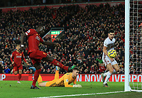 2nd January 2020; Anfield, Liverpool, Merseyside, England; English Premier League Football, Liverpool versus Sheffield United;  Sadio Mane of Liverpool beats Sheffield United goalkeeper Dean Henderson from close range to score his side's second goal after 64 minutes - Strictly Editorial Use Only. No use with unauthorized audio, video, data, fixture lists, club/league logos or 'live' services. Online in-match use limited to 120 images, no video emulation. No use in betting, games or single club/league/player publications