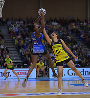 Grace Nweke (left) takes a pass under pressure from Sulu Fitzpatrick during the ANZ Premiership netball match between the Central Pulse and Northern Mystics at Te Rauparaha Arena in Wellington, New Zealand on Wednesday, 17 April 2019. Photo: Dave Lintott / lintottphoto.co.nz