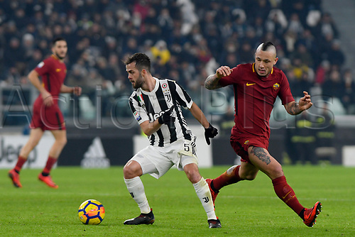 23rd December 2017, Allianz Stadium, Turin, Italy; Serie A football, Juventus versus Roma; Miralem Pjanic frees himself of the pressure from Radja Nainggolan