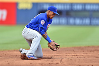 Chicago Cubs shortstop Addison Russell (27) fields a ball during a game against the Atlanta Braves at Turner Field on June 11, 2016 in Atlanta, Georgia. The Cubs defeated the Braves 8-2. (Tony Farlow/Four Seam Images)