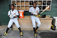 Infielder Dilson Herrera (31), left and Josh Ball (2) of the West Virginia Power in the dugout before a game against the Greenville Drive on Monday, April 15, 2013, at Fluor Field at the West End in Greenville, South Carolina. Herrera is the No. 20 prospect of the Pittsburgh Pirates and Bell is No. 6, according to Baseball America. West Virginia won, 6-0. (Tom Priddy/Four Seam Images)