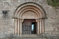 Sculptured portal with three carved archivolts supported by columns, Romanesque church of Santa Maria de Siurana, 12th century, Cornudella de Montsant, Priorat, Tarragona, Spain. A figure of Christ is carved on the tympanum. Picture by Manuel Cohen