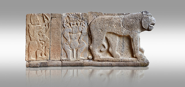 Pictures & images of the North Gate Hittite sculpture stele depicting Hittite Gods. 8th century BC. Karatepe Aslantas Open-Air Museum (Karatepe-Aslantaş Açık Hava Müzesi), Osmaniye Province, Turkey. Against grey background