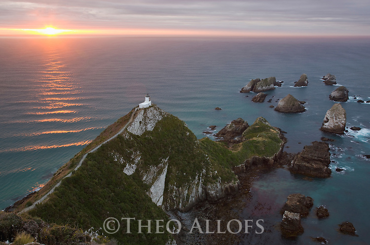 Light house at Nugget Point; sunrise; New Zealand, South Island