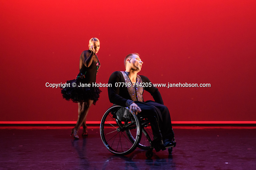 London, UK. 09.05.2018. Step Change Studios present their ballroom show Fusion, at Sadler's Wells' Lilian Baylis Studio. Fusion is the UK's first inclusive Latin and ballroom dance showcase by disabled and non-disabled artists, drawing on different dance influences such as swing and contemporary to develop original pieces inspired by Latin and ballroom. Picture shows: SHOW DANCE, created and performed by Nadine Kinczel and Pawel Karpinski. Photograph © Jane Hobson.
