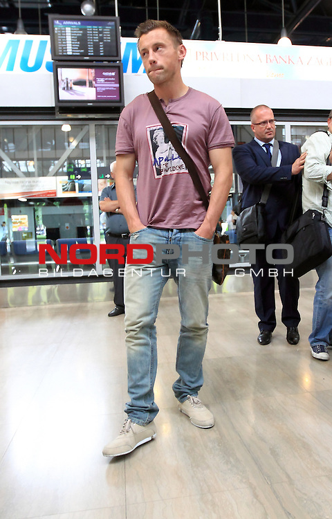 04.06.2012., Zagreb, Croatia - Croatia striker Ivica Olic and doctor Zoran Bahtijarevic arrived at Zagreb Airport from Muenchen. Olic has been ruled out of Euro 2012 with a thigh injury which he sustained in the 1-1 friendly draw against Norway at the weekend.  A scan has revealed a partial rupture of the biceps muscle in the 32-year-old's right thigh, with an estimated recovery time of four to six weeks. Bilic has acted quickly to replace Olic, calling Dnipro striker Nikola Kalinic into the squad. <br /> <br /> Foto &copy;  nph / PIXSELL / Zeljko Lukunic