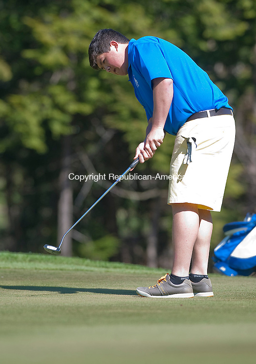 WINSTED, CT 25 APRIL 2013--042513JS06-- Shepaug's Spencer Ylagan putts during their match against Gilbert and Terryville Thursday at Green Woods Country Club in Winsted. .Jim Shannon Republican-American.