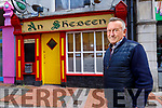 Richie Houlihan standing outside his pub An Shebeen.