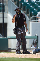 Home plate umpire Jansen Visconti makes a strike call during the International League game between the Gwinnett Stripers and the Charlotte Knights at BB&T BallPark on May 2, 2018 in Charlotte, North Carolina.  The Knights defeated the Stripers 6-5.  (Brian Westerholt/Four Seam Images)
