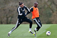 Thursday 20 March 2014<br /> Pictured:( L-R ) Chico Flores and Leroy Lita<br /> Re: Swansea City Training at their Fairwood training facility, Swansea, Wales,UK