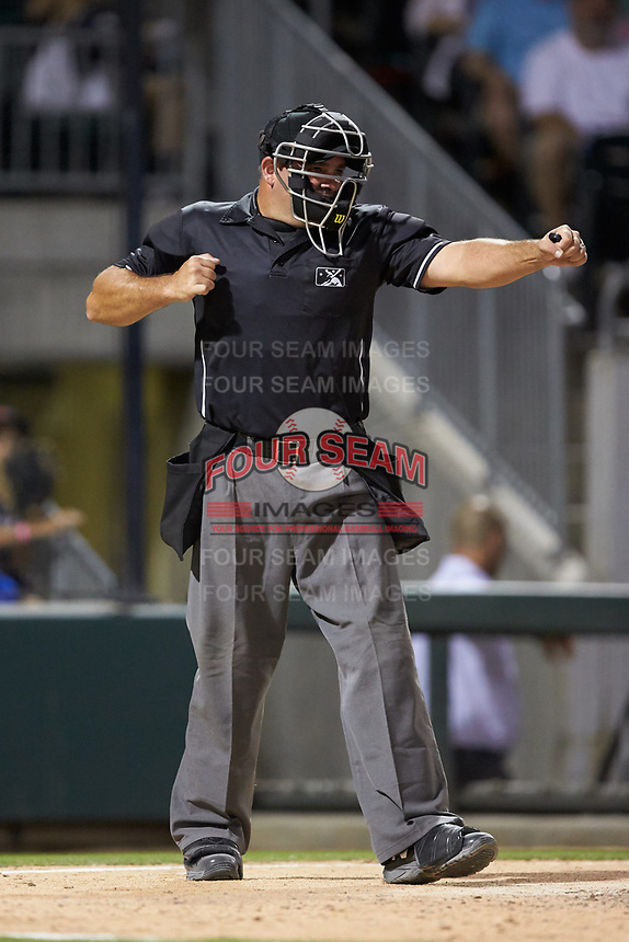 Home plate umpire Jeremy Riggs calls a batter out on strikes during the International League game between the Toledo Mud Hens and the Charlotte Knights at BB&T BallPark on June 22, 2018 in Charlotte, North Carolina. The Mud Hens defeated the Knights 4-0.  (Brian Westerholt/Four Seam Images)