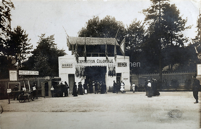 Entrance gate to the Colonial Exhibition of 1907, held in the Jardin d'Agronomie Tropicale, or Garden of Tropical Agronomy, in the Bois de Vincennes in the 12th arrondissement of Paris, postcard from the nearby Musee de Nogent sur Marne, France. The garden was first established in 1899 to conduct agronomical experiments on plants of French colonies. In 1907 it was the site of the Colonial Exhibition and many pavilions were built or relocated here. The garden has since become neglected and many structures overgrown, damaged or destroyed, with most of the tropical vegetation disappeared. The site is listed as a historic monument. Picture by Manuel Cohen / Musee de Nogent sur Marne