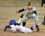Western Nevada College's Melanie Pfeiffer dives safely back to second base under the tag of College of Southern Idaho's TJ Surrage during a college softball game in Carson City, Nev., on Friday, March 16, 2012. CSI defeated WNC 12-3, 11-3 and 14-0. The teams will face off Saturday, March 17 at noon at Edmonds Sports Complex in Carson, weather permitting..Photo by Cathleen Allison/Nevada Photo Source