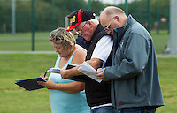 13 SEP 2014 - IPSWICH, GBR - Team officials prepare scoresheets before the start of the 2014 British Open Club Cycle Speedway Championships at Whitton Sports & Community Centre in Ipswich, Great Britain (PHOTO COPYRIGHT © 2014 NIGEL FARROW, ALL RIGHTS RESERVED)