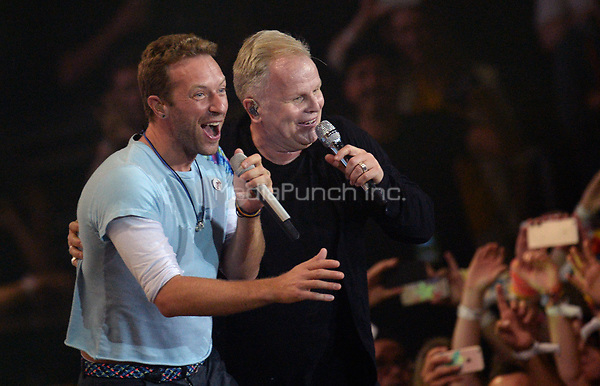 Chris Martin (L) from Coldplay and Herbert Groenemeyer perform at the first Global Citizen Festival concert in Hamburg, Germany, 6 July 2017. Photo: Daniel Reinhardt/dpa /MediaPunch ***FOR USA ONLY***