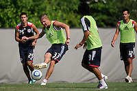 Carl Robinson (33) passes the ball during a New York Red Bulls practice on the campus of Montclair State University in Upper Montclair, NJ, on July 16, 2010.