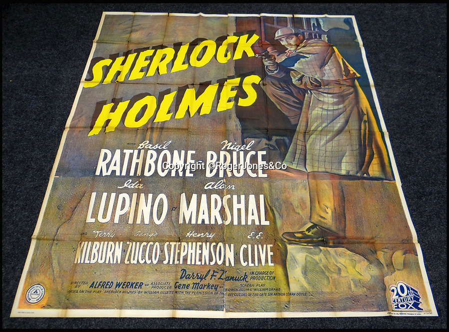 BNPS.co.uk (01202 558833)<br /> Pic: RogerJones&Co/BNPS<br /> <br /> Elementary success - Basil Rathbone's first Sherlock Holmes outing sold for £15,600.<br /> <br /> A rare collection of 1930s and 40s cinema posters discovered by two builders after they were used as carpet underlay have sold for a whopping £75,000.<br /> <br /> More than half the total was made on a single poster, John Wayne's breakthrough film Stagecoach (1939), which sold for £31,000.<br /> <br /> The classic Hollywood movie posters, which were in near pristine condition, are from the halcyon days of cinema and included well known names such as Alfred Hitchcock, Sir Laurence Olivie and Boris Karloff.<br /> <br /> Before the sale auctioneers Rogers Jones & Co said it was difficult to predict what the posters would sell for as no comparisons had ever come to market but the collection of about 120 posters was expected to fetch several thousands.<br /> <br /> Two builders made the discovery in 1985 when they were renovating the home of a local cinema owner who had died in Penarth, south Wales.