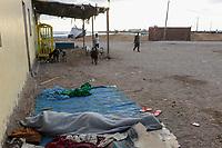 DJIBOUTI , Obock, from here ethiopian migrants try to cross bab el mandeb, red sea, gulf of aden by smuggler boats to Yemen to continue the journey to Saudi Arabia or Europe, ethiopian migrants sleeping outside at the sea / DSCHIBUTI, Obock, Meerenge Bab el Mandeb, mit Hilfe von Schleppern veruchen aethiopische Migranten hier nach Jemen ueberzusetzen, um weiter nach Saudi Arabien oder Europa zu gelangen, Fluechtlinge schlafen in der Nacht am Hafen
