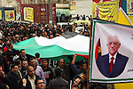 Palestinian Fatah supporters hold Palestine flags and posters of Palestinian President Mahmoud Abbas during a support rally in West Bank City of Hebron, 17 March 2014. Thousands of Palestinians in several cities in the West Bank demonstrated in support of President Mahmoud Abbas, Abbas will meet US President Barack Obama to discuss the crisis in peace talks with Israel ahead of a looming April deadline. Photo by Mamoun Wazwaz