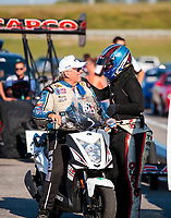 Sep 27, 2019; Madison, IL, USA; NHRA top fuel driver Steve Torrence (right) with funny car driver John Force during qualifying for the Midwest Nationals at World Wide Technology Raceway. Mandatory Credit: Mark J. Rebilas-USA TODAY Sports