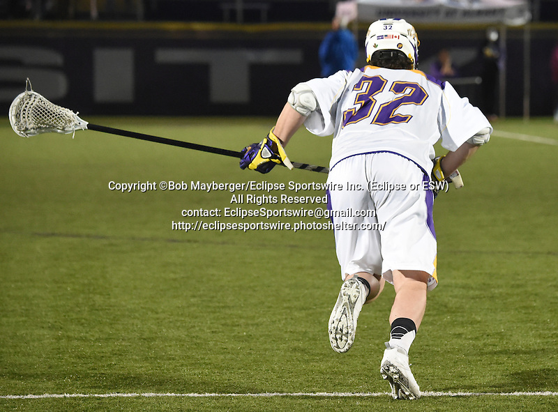 Game action from a men's lacrosse game which saw Albany defeat cross-town rival Siena 19-11 on April 22, 2014 at John Fallon Field in Albany, New York.  (Bob Mayberger/Eclipse Sportswire)