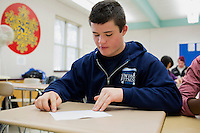 Students complete a paper-folding exercise as part of an MIT Blossoms lesson on exponential growth in Sandra Haupt's Intro to Calc class at Concord-Carlisle Regional High School in Concord, MA, USA. The class has partnered with MIT Blossoms to use video education tools in conjunction with regular lessons to reinforce key concepts.
