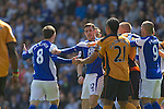 Tempers flare amongst opposing players including Barry Ferguson (centre) at St. Andrew's stadium, during Birmingham City's Barclay's Premier League match with Wolverhampton Wanderers. Both clubs were battling against relegation from  England's top division. The match ended in a 1-1 draw, watched by a crowd of 26,027.