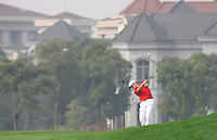 Jamie Donaldson (WAL) plays his 2nd shot on the 10th hole during Friday's Round 2 of the 2014 BMW Masters held at Lake Malaren, Shanghai, China 31st October 2014.<br /> Picture: Eoin Clarke www.golffile.ie