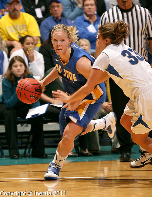 SIOUX FALLS, SD - MARCH 7: Kristin Rotert #14 of South Dakota State drives against Jordan Zuppe #33 from IPFW during the second half of their semi-final game at the 2011 Summit League Basketball Championships in Sioux Falls, S.D.(Photo by Dave Eggen/Inertia)