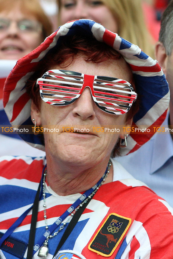 A GB fan enjoys the game - Great Britain Women vs Brazil Women - Womens Olympic Football Tournament London 2012 Group E at Wembley Stadium, London - 31/07/12 - MANDATORY CREDIT: Gavin Ellis/SHEKICKS/TGSPHOTO - Self billing applies where appropriate - 0845 094 6026 - contact@tgsphoto.co.uk - NO UNPAID USE.