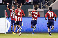 CD Chivas USA midfielder Blair Gavin (18 arms raised) celebrates his goal with teammates Ante Jazic (6), Jonathan Bornstein (13) and Michael Lahoud (11). The Philadelphia Union and CD Chivas USA played to 1-1 draw at Home Depot Center stadium in Carson, California on Saturday evening July 3, 2010..