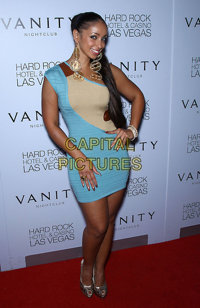 Mya (Mya Marie Magro).performs and walks the red carpet at Vanity Nightclub inside the Hard Rock Hotel and Casino, Las Vegas, NV,19th August 2011..full length one shoulder blue beige dress  silver peep toe shoes hand on hip gold dangly earrings .CAP/ADM/MJT.© MJT/AdMedia/Capital Pictures.