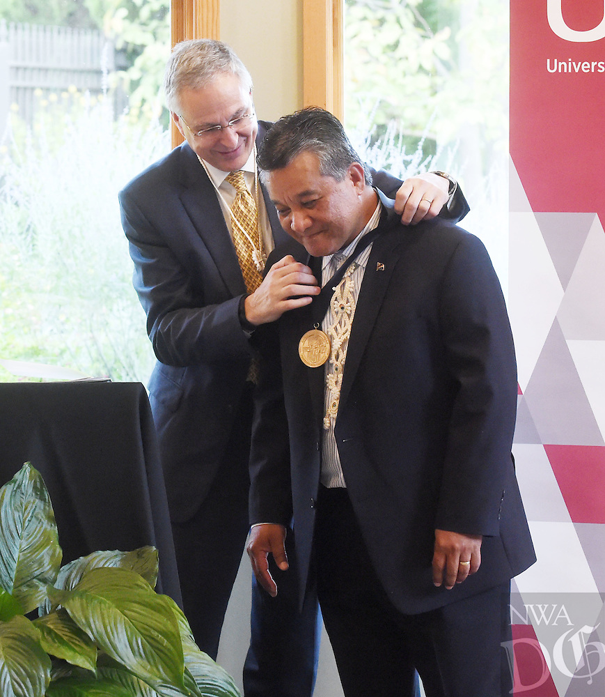 NWA Democrat-Gazette/MICHAEL WOODS &bull; @NWAMICHAELW<br /> Daniel W. Rahn, M.D., Chancellor with UAMS, presents Sheldon Riklon, M.D. as the inaugural recipient of the Peter O. Kohler, M.D., Endowed Distinguished Professorship in Health Disparities Thursday, September 15, 2016 during the official ceremonies at the Botanical Garden of the Ozarks.  Dr. Sheldon Riklon, a UAMS associate professor in the Department of Family and Preventative Medicine and one of two Marshallese physicians in the world who has completed medical school and residency training in the U.S., was named the first holder of the Peter O. Kohler M.D. Endowed Distinguished Professorship in Health Disparities. Kohler recently announced his retirement for the end of the year as vice chancellor of the medical school&rsquo;s vice chancellor.