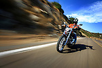SAN DIEGO, CA - JULY 21:  Helmut Herb rides a Harley Davidson Softtail through Elfin Forest Road during the Harley Davidson Release test ride for Stern Magazine on July 21 in San Diego, California. (Photo by Donald Miralle) *** Local Caption *** Helmut Werb