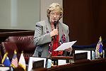 Nevada Sen. Joyce Woodhouse, D-Henderson, works on the Senate floor at the Legislative Building in Carson City, Nev., on Monday, April 20, 2015. <br /> Photo by Cathleen Allison
