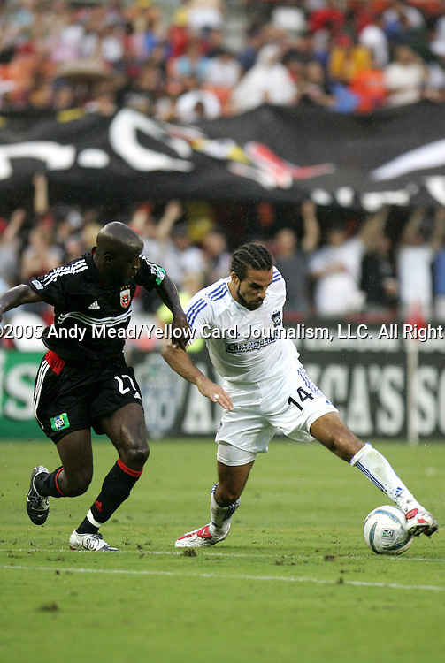15 July 2005: John Wilson (27) challenges Dwayne DeRosario (14). DC United defeated the San Jose Earthquakes 3-0 at RFK Stadium in Washington, DC in a regular season Major League Soccer game.